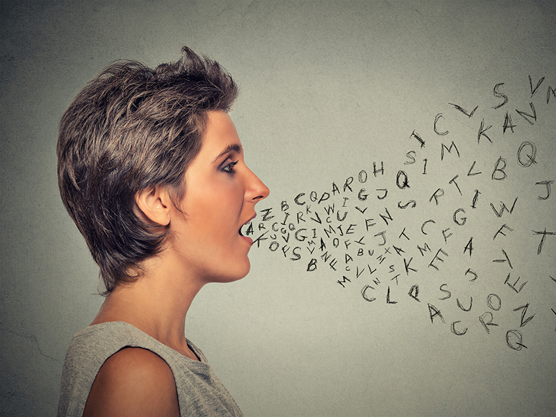 Picture of a woman with letters coming out her mouth