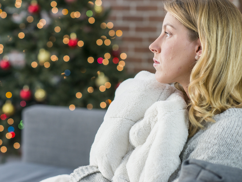 Woman with hearing loss feeling isolated during holidays.