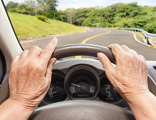 Picture of senior driver behind the wheel | How Does Hearing Loss Affect Your Driving Skills?