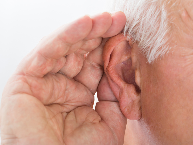 Picture of hand up to an ear