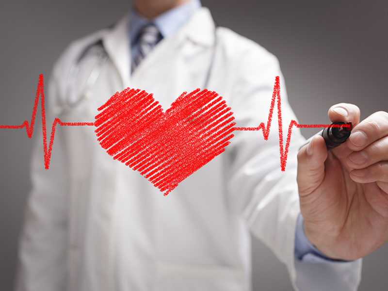 Picture of doctor drawing a heart