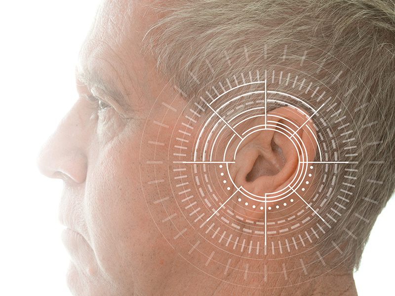 Picture of the side of a man's head with target on ear.