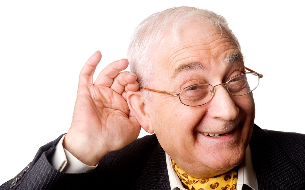 Man holding hand up to his ear suffering from single sided deafness.