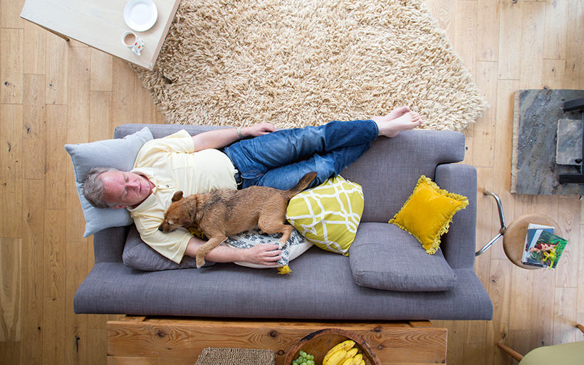 Picture of a guy lying on the couch.