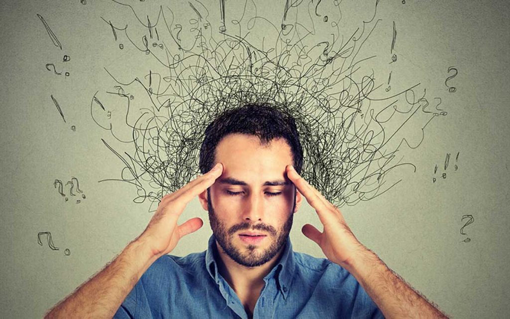 Man with lots of stress suffering from Tinnitus.