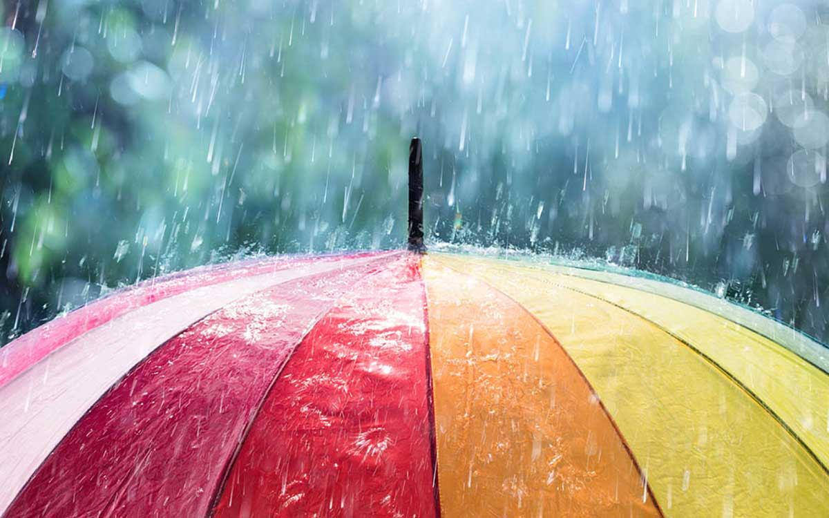 Umbrella with rain coming down. Protecting your hearing aids.