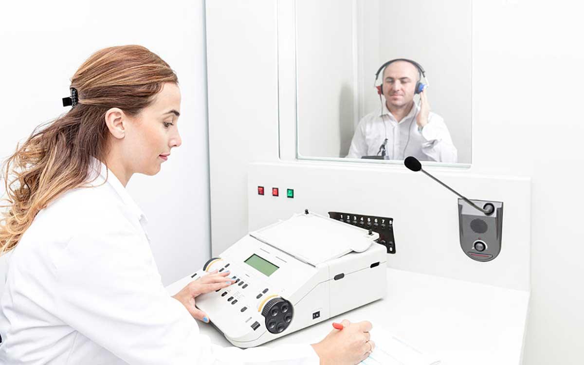 Man taking a hearing test.