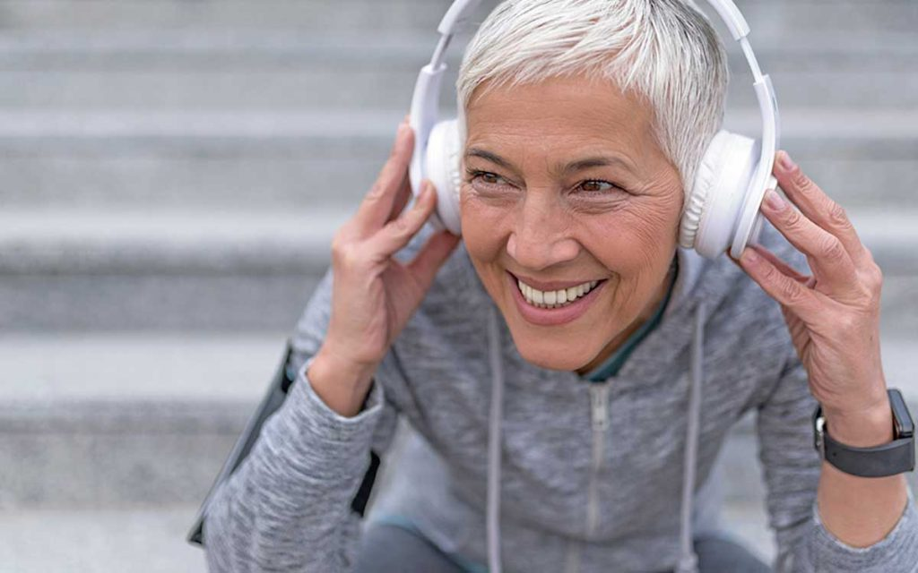 Woman wearing headphones.