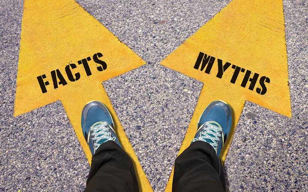 Arrows pointing to facts and myths about hearing aids.