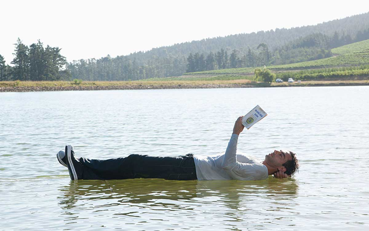 Man appearing to float on water. Misconception of Tinnitus.