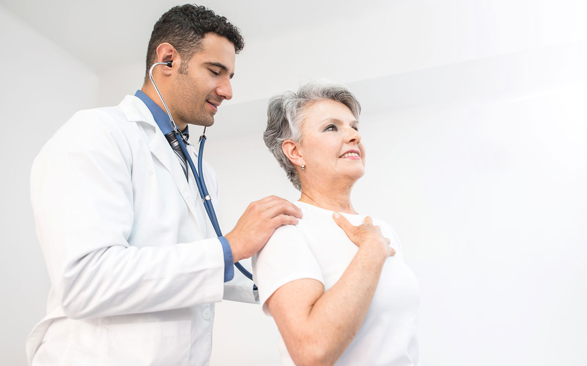 Woman getting her heart checked suffering from hearing loss.