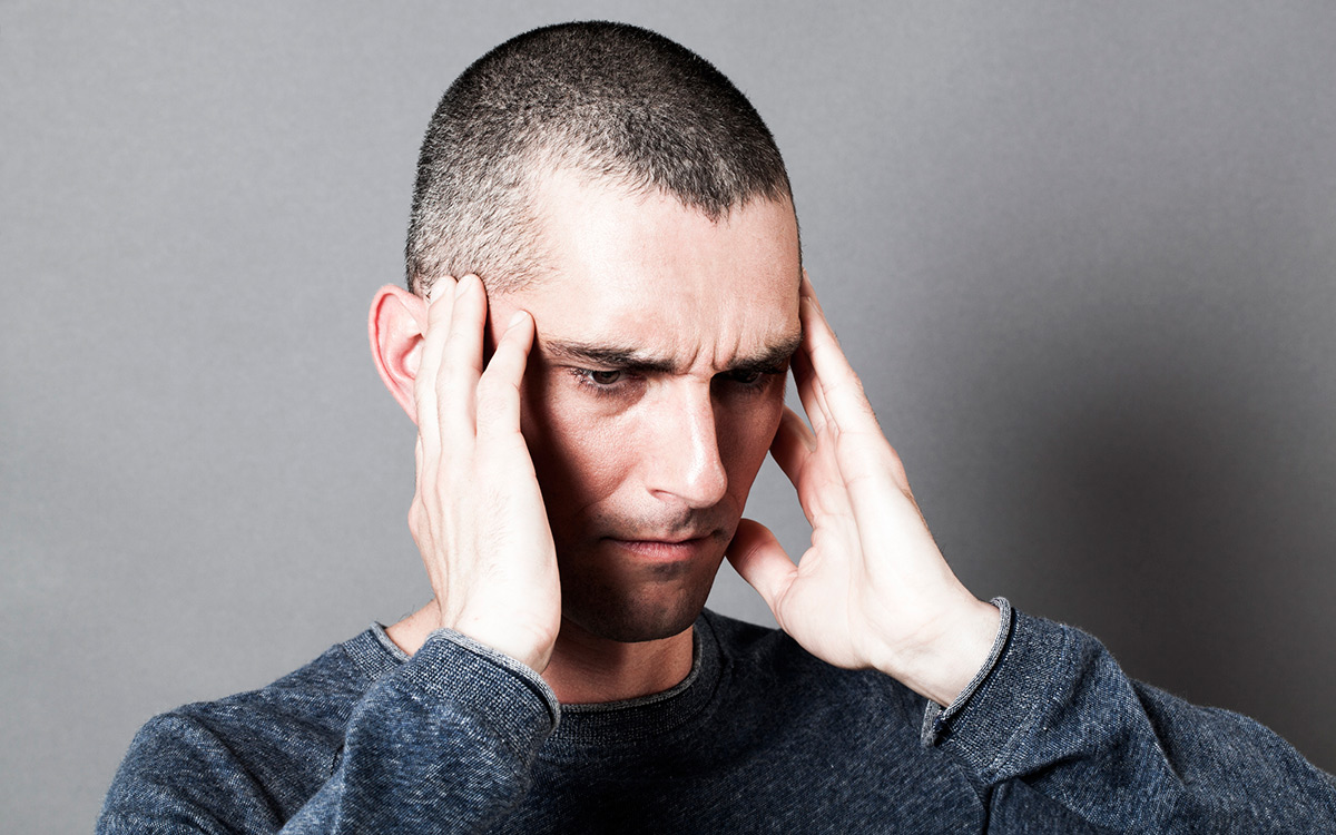 Tinnitus sufferer ignoring symptoms of hearing loss.