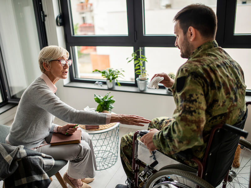 veteran talking to a professional about his hearing loss