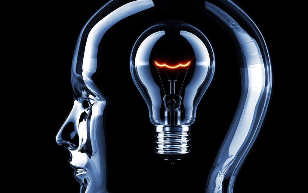 Head with lightbulb representing training your ear.