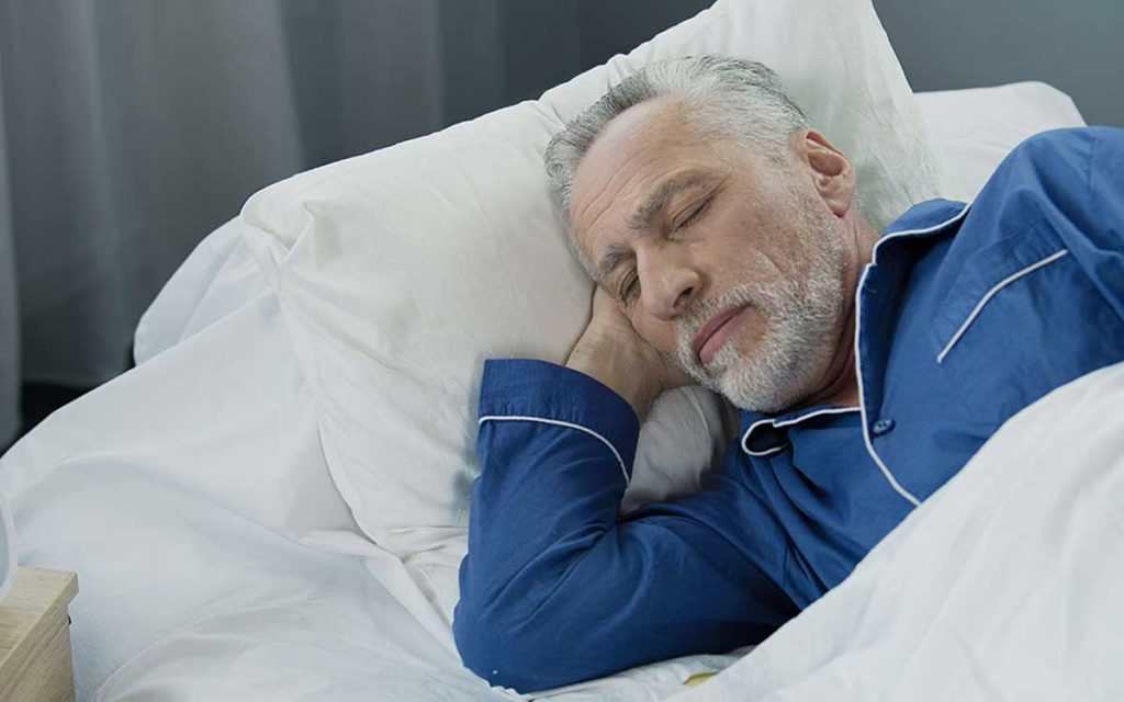 Man sleeping well even though he has Tinnitus.
