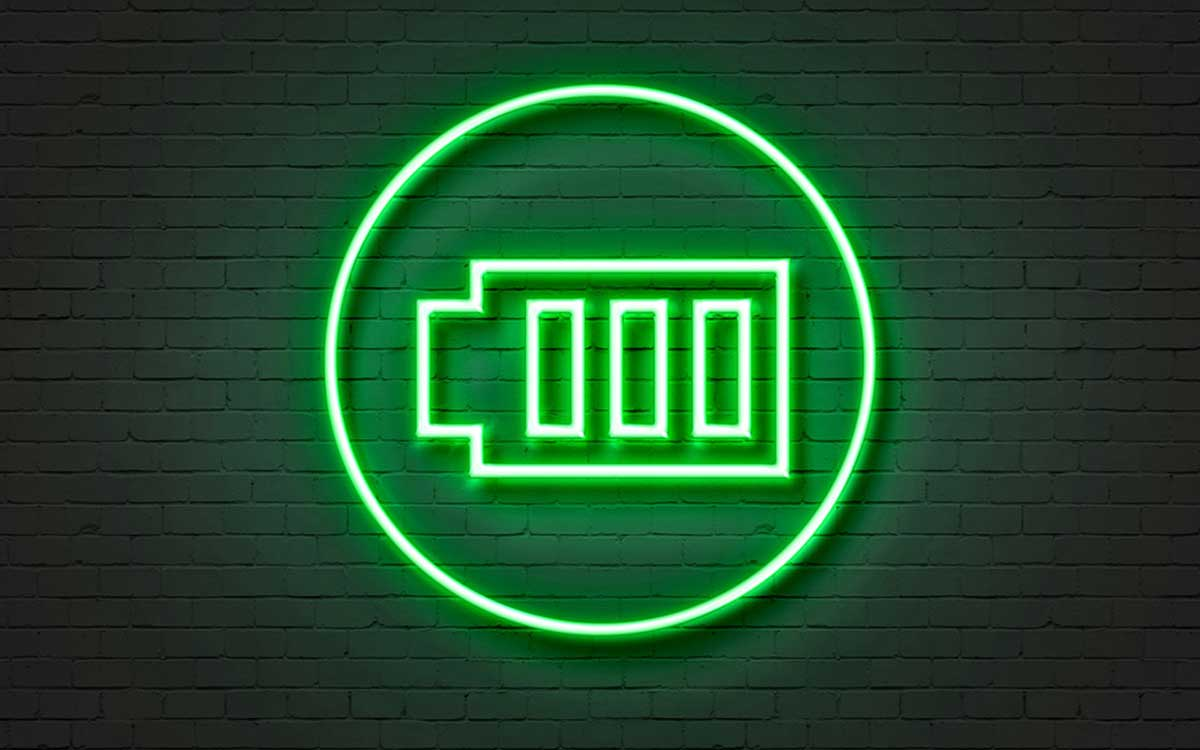 Neon sign of green rechargeable hearing aid batteries.