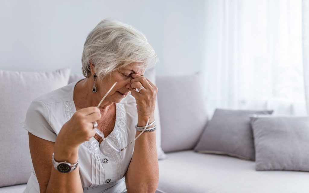 Woman feeling very tired and fatigued because of hearing loss.