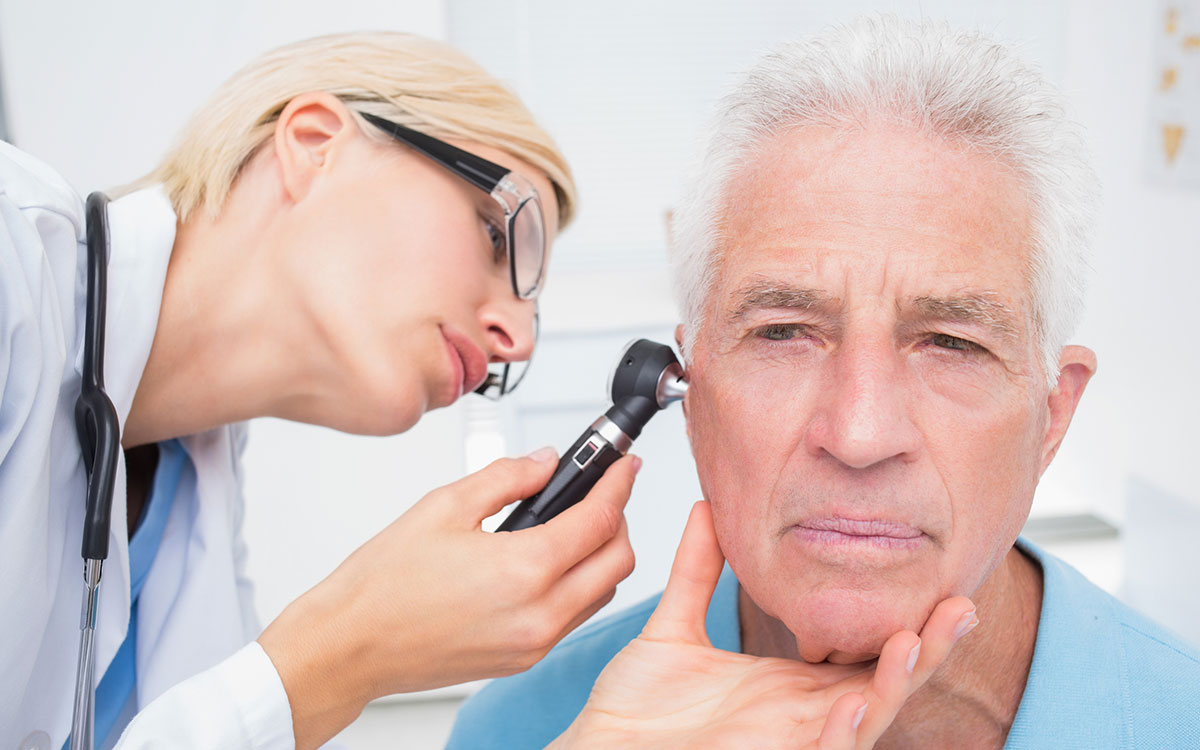 Man getting a checkup after getting hearing aids.