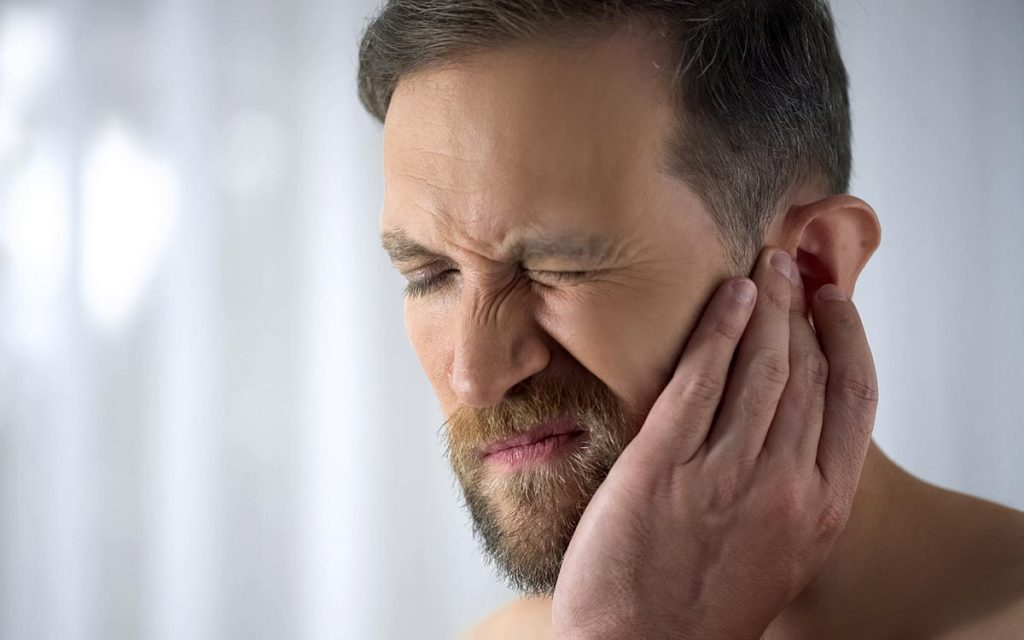 Man suffering from Hyperacusis and Tinnitus.