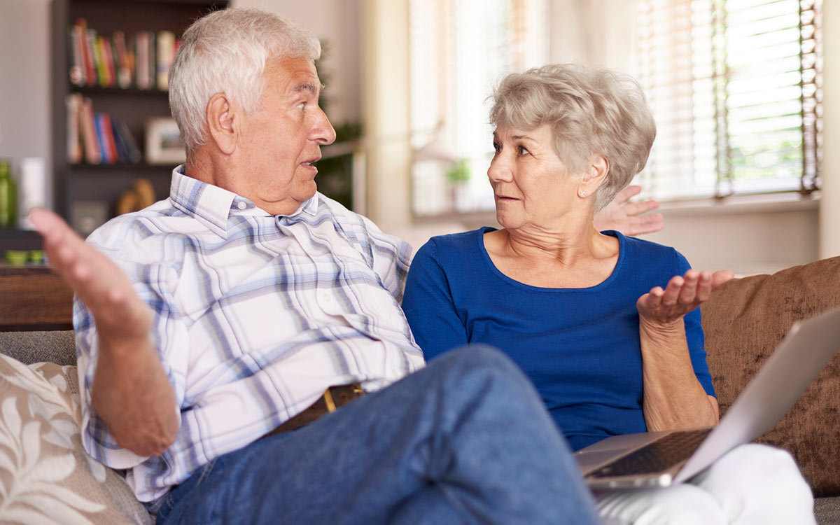 Couple looking very surprised about hearing loss facts.
