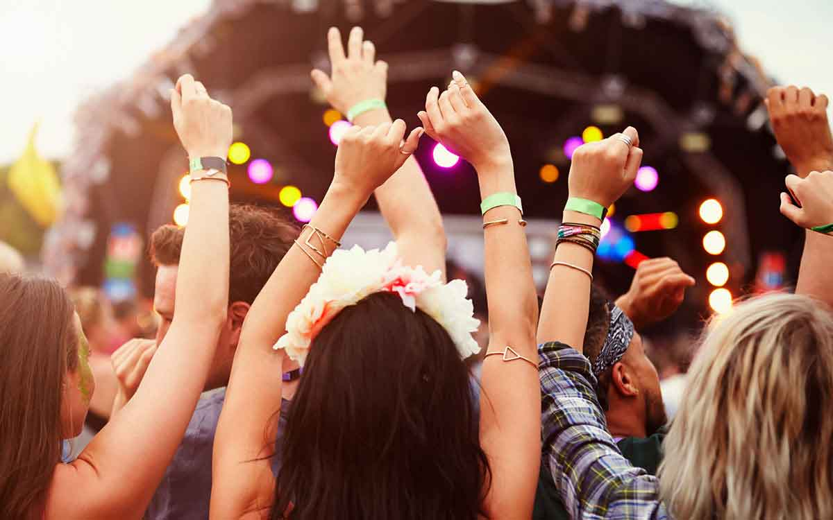 Concert goers who need to use ear plugs for hearing protection.