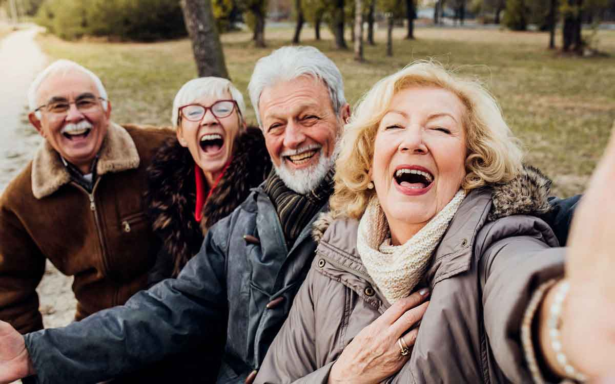 Happy seniors effected by hearing loss.