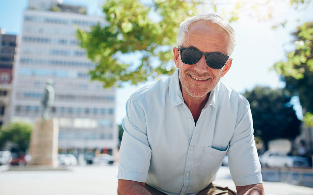 Senior man with sunglasses on. Hearing aids are cool.