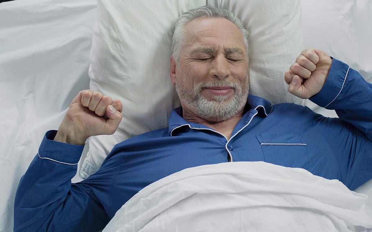 Man who's had a good night sleep because of hearing aids.