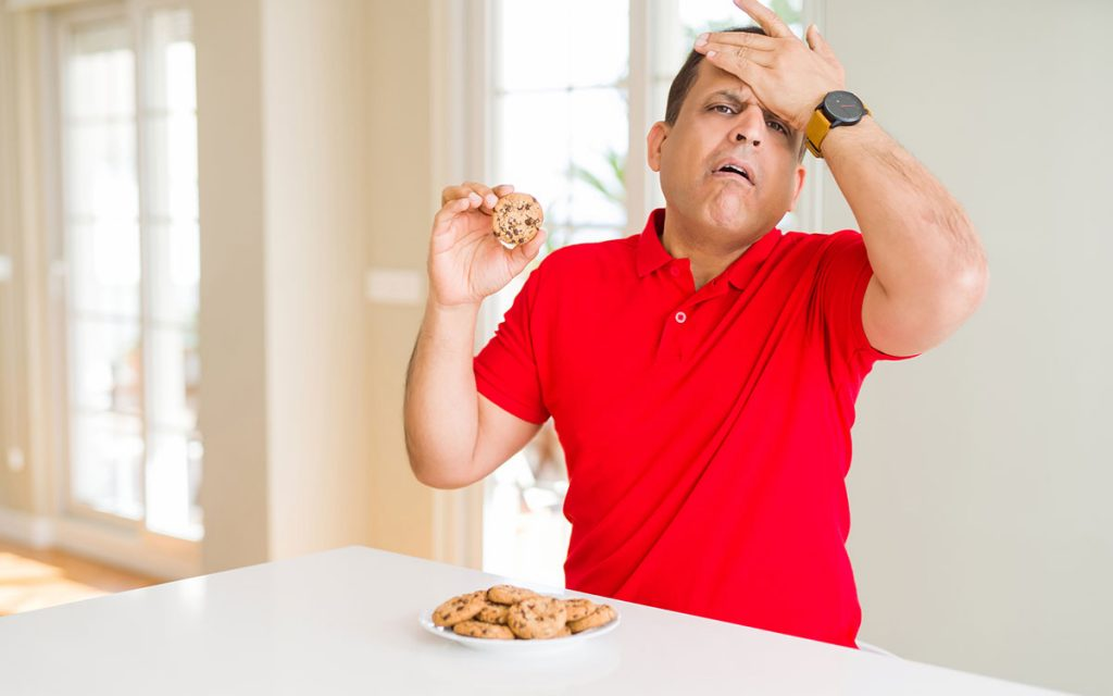 Man eating foods that make his Tinnitus worse.