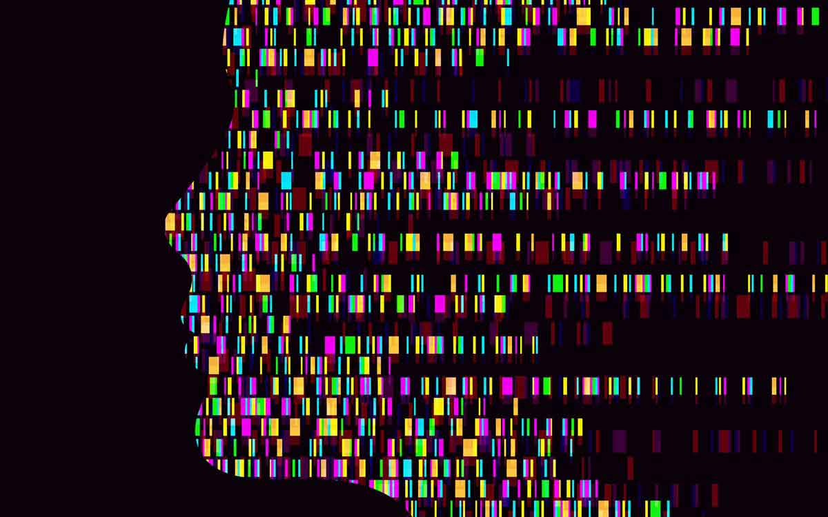Silhouette of face with genes in representing hereditary hearing loss.