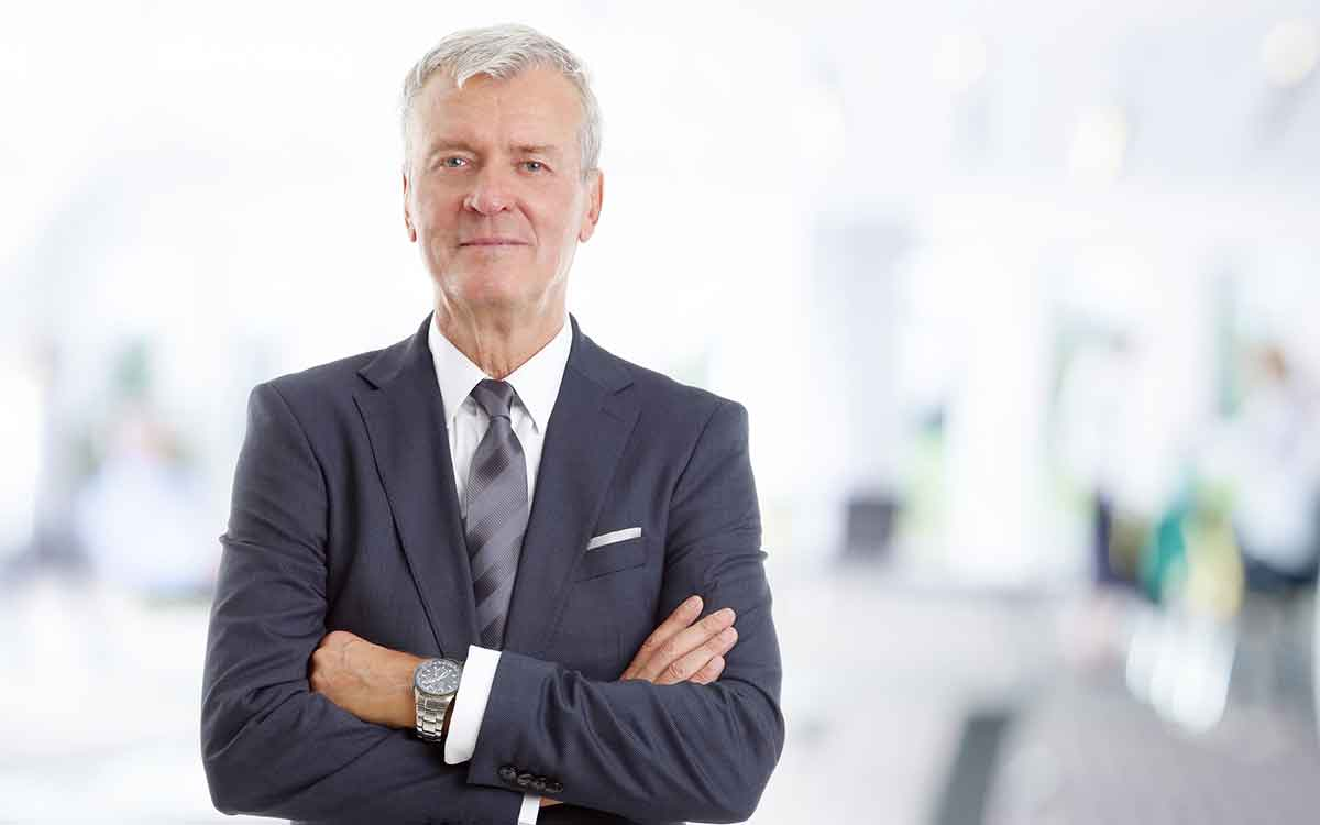 Businessman wearing hearing aids to help his career.
