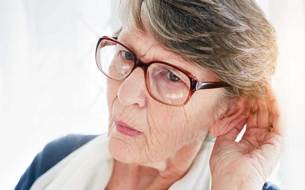 Woman who is sufering from the first signs of age related hearing loss.