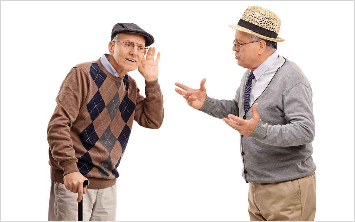 Two senior men having difficulty communicating.