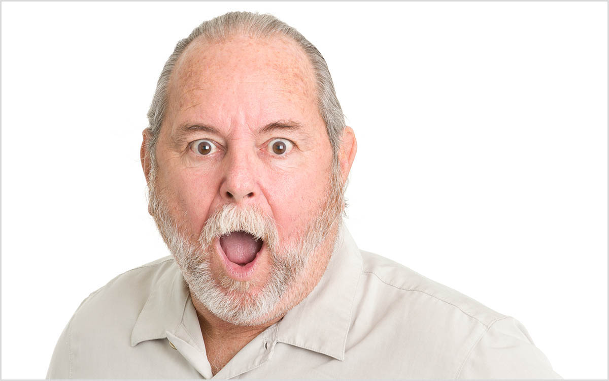 Frightened man who has put off a hearing loss.