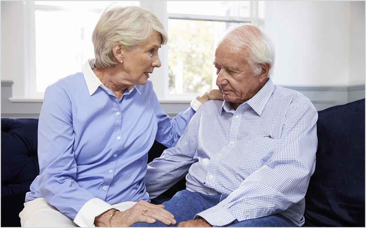 Senior couple talking about hearing loss and hearing aids.