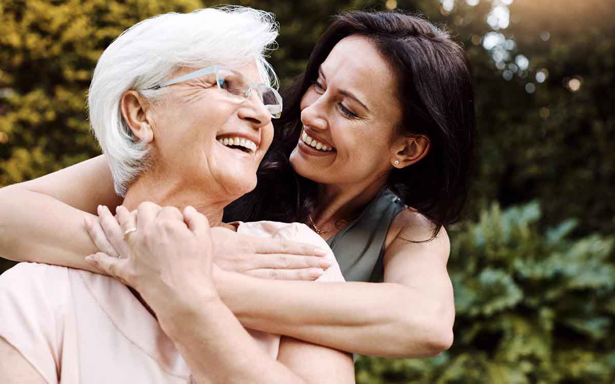 Shot of a happy senior woman spending quality time with her daughter and caring for her hearing loss.