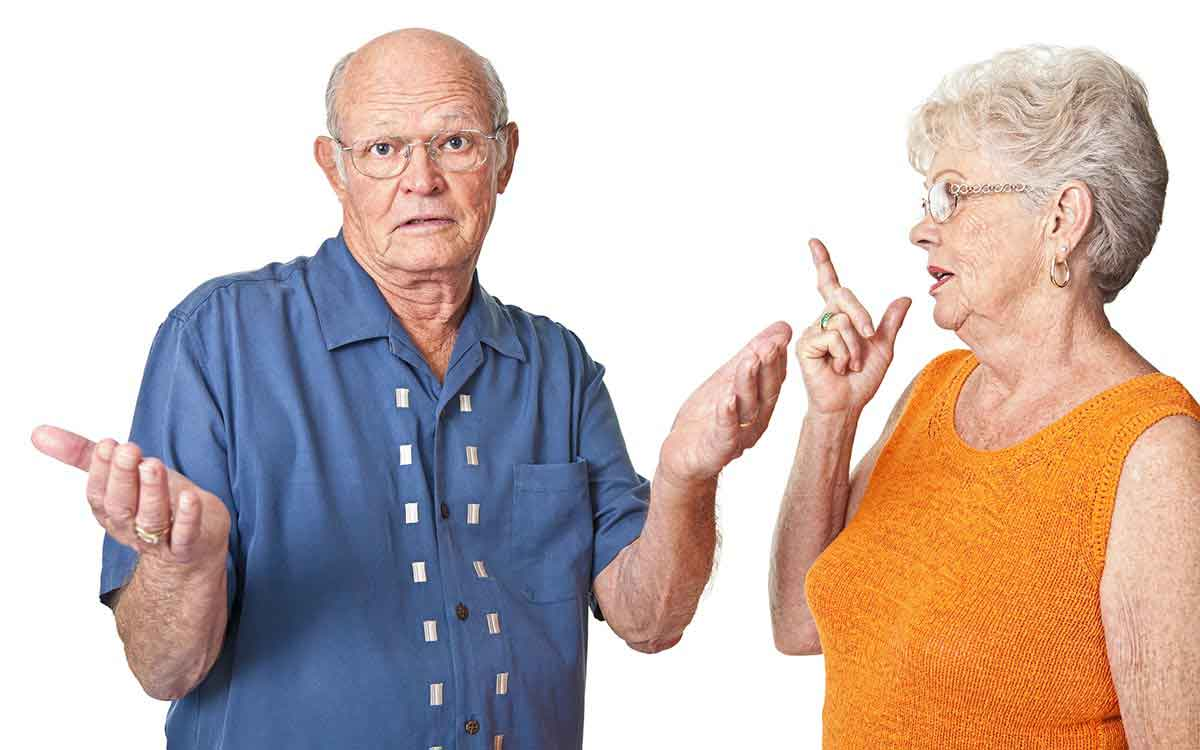 A senior couple having a discussion about hearing loss.