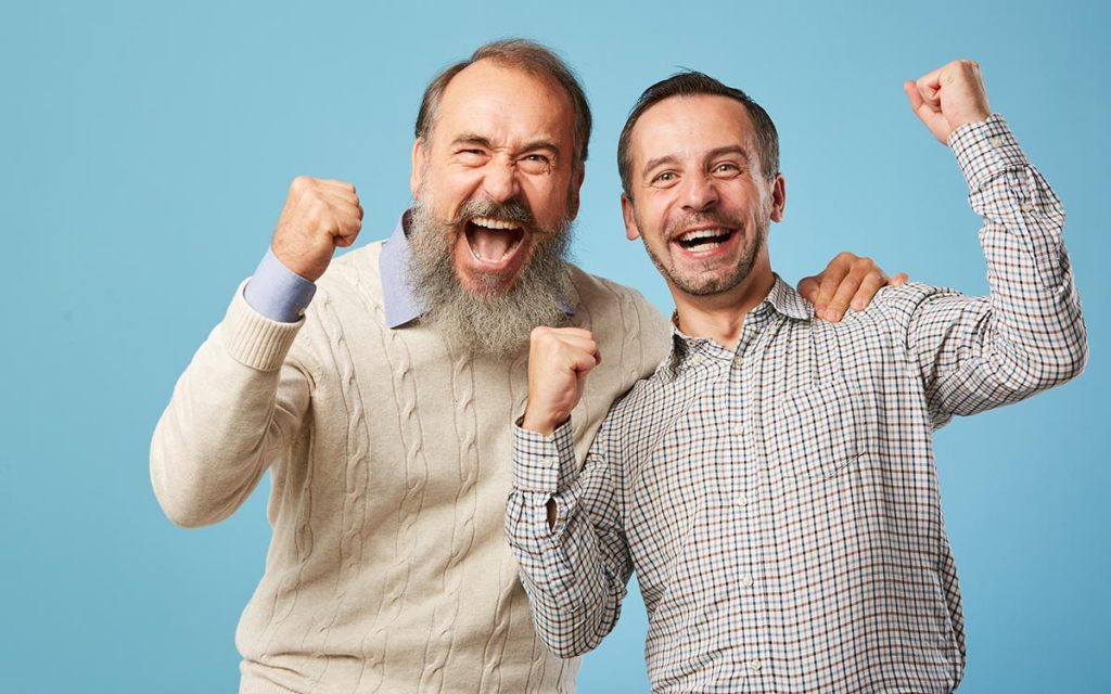 Excited men because hearing aids are the best they've ever been.